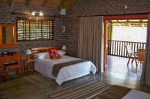 Open plan chalet with two beds.